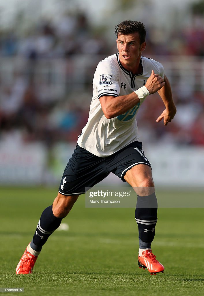 Gareth Bale of Tottenham Hotspur in action during the pre season friendly between Tottenham Hotspur and Swindon Town at the County Ground on July 16, 2013 in Swindon, England.