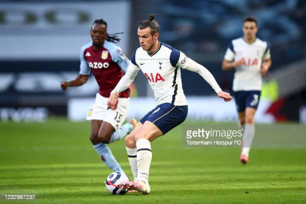 Gareth Bale of Tottenham Hotspur in action with Bertand Traore of Aston Villa during the Premier League match between Tottenham Hotspur and Aston...