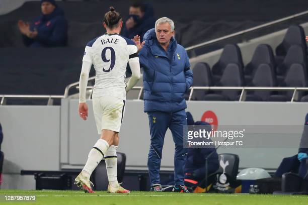 Gareth Bale of Tottenham Hotspur interacts with Jose Mourinho Manager of Tottenham Hotspur as he is substituted during the UEFA Europa League Group J...