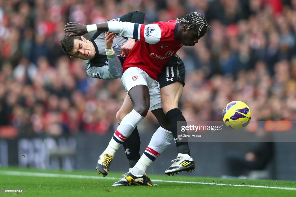 Gareth Bale of Tottenham Hotspur is challenged by Bacary Sagna of Arsenal during the Barclays Premier league match between Arsenal and Tottenham Hotspur at Emirates Stadium on November 17, 2012 in London, England.