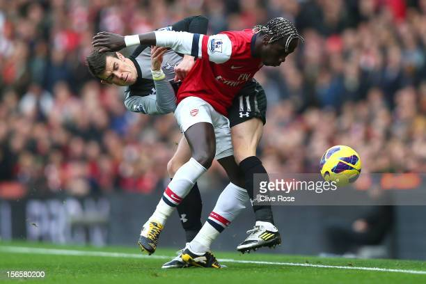 Gareth Bale of Tottenham Hotspur is challenged by Bacary Sagna of Arsenal during the Barclays Premier league match between Arsenal and Tottenham...