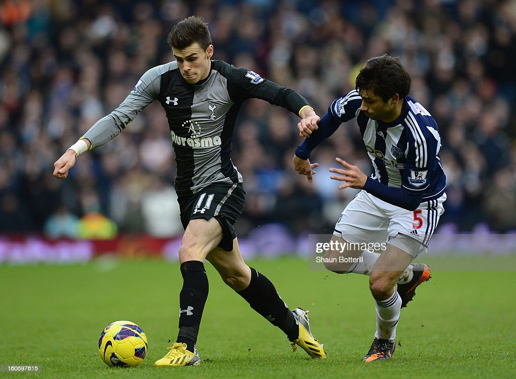 Gareth Bale of Tottenham Hotspur is challenged by Claudio Yacob of West Bromwich Albion during the Barclays Premier League match between West Bromwich Albion and Tottenham Hotspur at The Hawthorns on February 3, 2013 in West Bromwich, England.