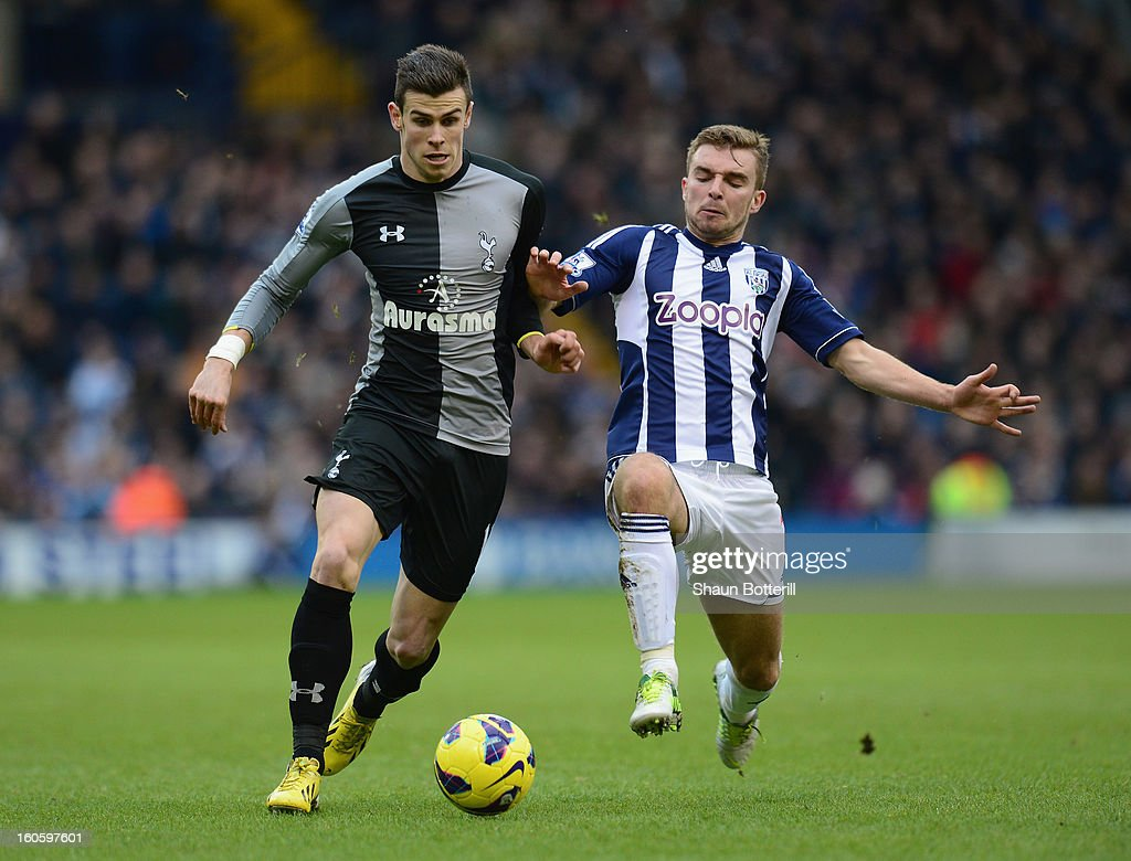 Gareth Bale of Tottenham Hotspur is challenged by James Morrison of West Bromwich Albion during the Barclays Premier League match between West Bromwich Albion and Tottenham Hotspur at The Hawthorns on February 3, 2013 in West Bromwich, England.