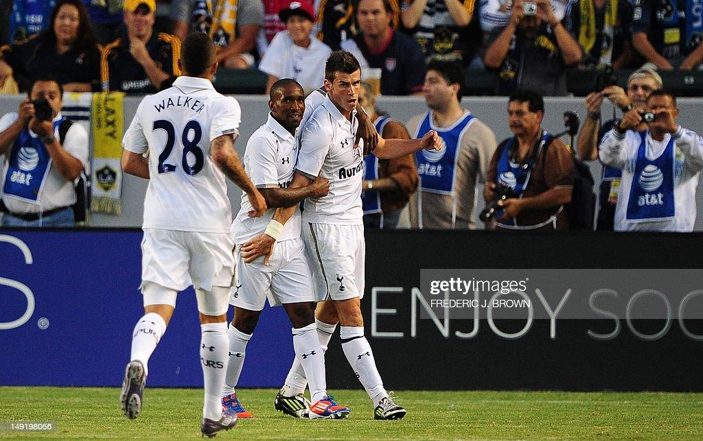 Gareth Bale (R) of Tottenham Hotspur is  : News Photo