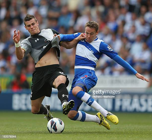Gareth Bale of Tottenham Hotspur is tackled by Chris Gunter of Reading during the Barclays Premier League match between Reading and Tottenham Hotspur...
