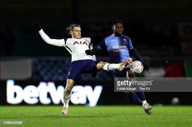 Gareth Bale of Tottenham Hotspur is tackled by Fred Onyedinma of Wycombe Wanderers during The Emirates FA Cup Fourth Round match between Wycombe...