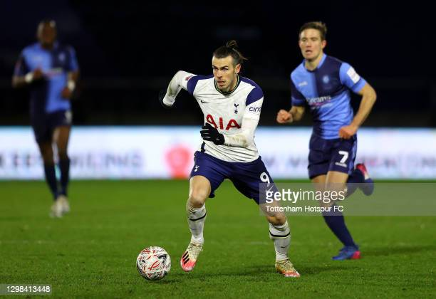 Gareth Bale of Tottenham Hotspur looks to break past David Wheeler of Wycombe Wanderers during The Emirates FA Cup Fourth Round match between Wycombe...