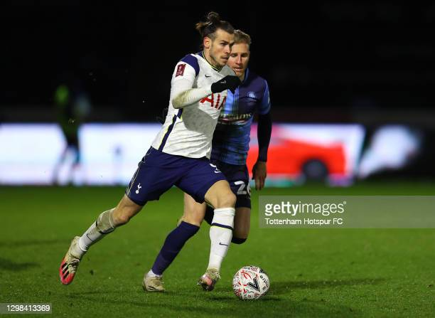 Gareth Bale of Tottenham Hotspur looks to break past Jason McCarthy of Wycombe Wanderers during The Emirates FA Cup Fourth Round match between...