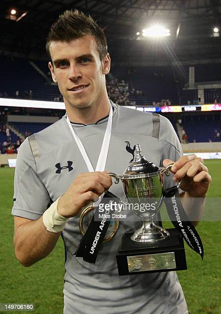 Gareth Bale of Tottenham Hotspur poses for a photo with the Under Armour Man of the Match Trophy after defeating the New York Red Bulls at Red Bull...