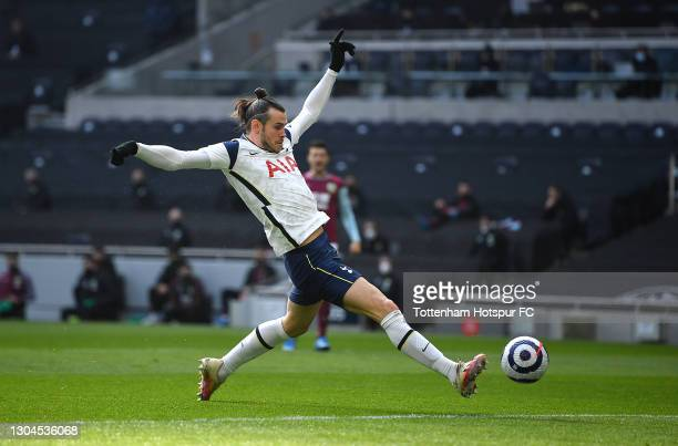 Gareth Bale of Tottenham Hotspur scores their side's first goal during the Premier League match between Tottenham Hotspur and Burnley at Tottenham...