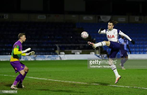 Gareth Bale of Tottenham Hotspur scores their sides first goal past Ryan Allsop of Wycombe Wanderers during The Emirates FA Cup Fourth Round match...