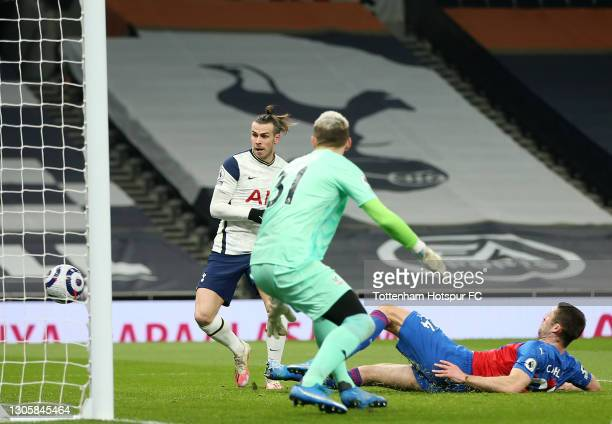 Gareth Bale of Tottenham Hotspur scores their sides first goal past Vicente Guaita of Crystal Palace during the Premier League match between...
