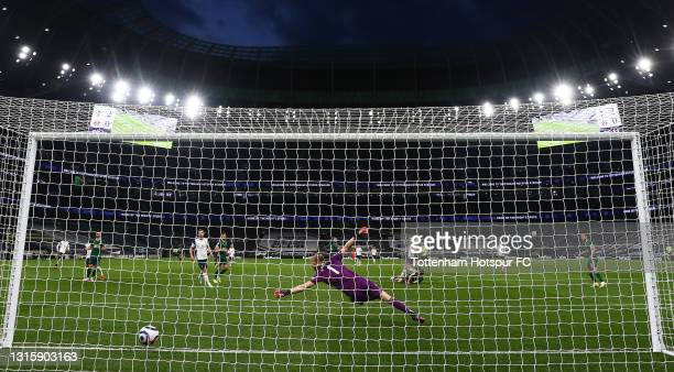 Gareth Bale of Tottenham Hotspur scores their side's second goal past Aaron Ramsdale of Sheffield United during the Premier League match between...