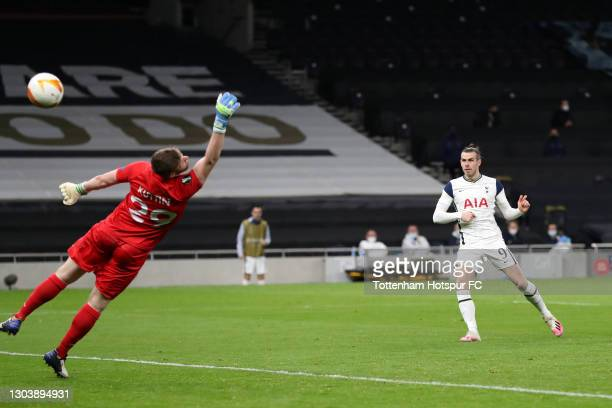 Gareth Bale of Tottenham Hotspur scores their team's third goal past Manuel Kuttin of Wolfsberger AC during the UEFA Europa League Round of 32 match...