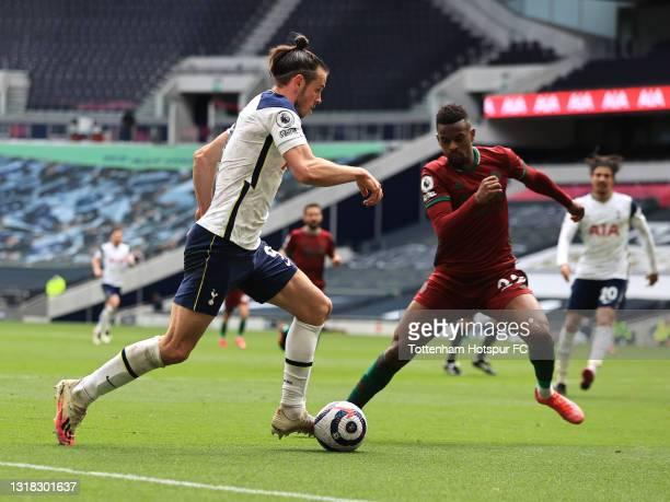 Gareth Bale of Tottenham Hotspur takes on Nelson Semedo of Wolverhampton Wanderers during the Premier League match between Tottenham Hotspur and...