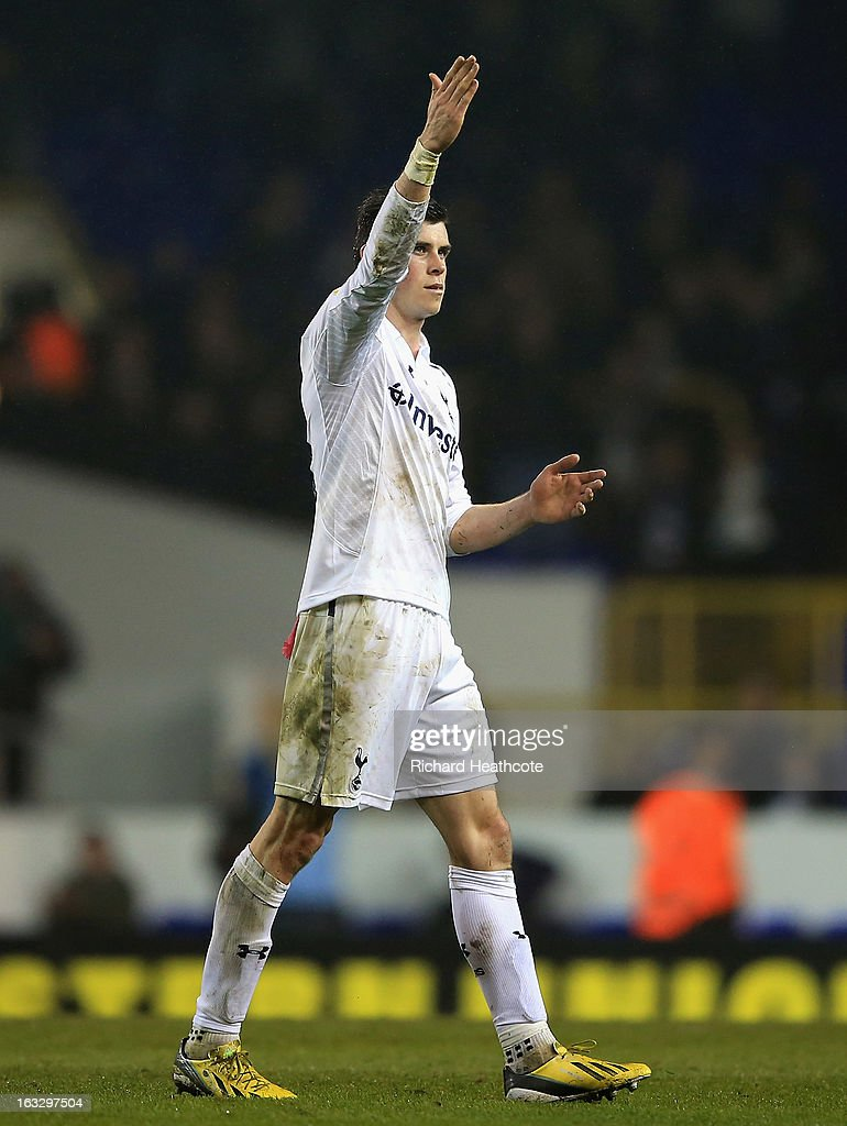 Gareth Bale of Tottenham Hotspur waves to fans after victory in the UEFA Europa League Round of 16 First Leg match between Tottenham Hotspur and FC Internazionale Milano at White Hart Lane on March 7, 2013 in London, England.