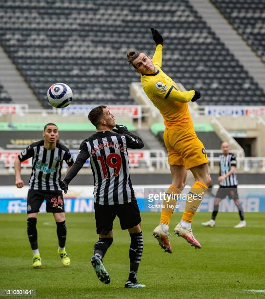 Gareth Bale of Tottenham Hotspur wins a header from Javier Manquillo of Newcastle United FC during the Premier League match between Newcastle United...