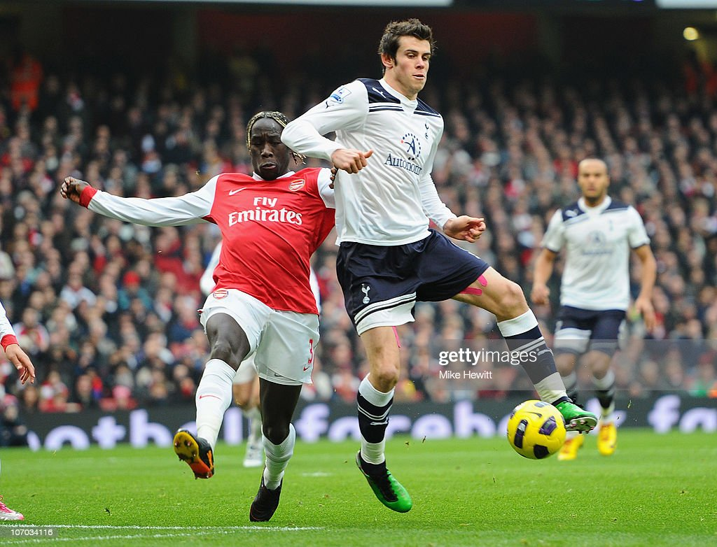 Gareth Bale of Tottenham is challenged by Bacary Sagna of Arsenal during the Barclays Premier League match between Arsenal and Tottenham Hotspur at the Emirates Stadium on November 20, 2010 in London, England.