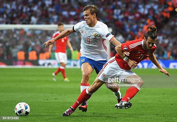 Gareth Bale of Wales and Aleksandr Kokorin of Russia compete for the ball during the UEFA EURO 2016 Group B match between Russia and Wales at Stadium...