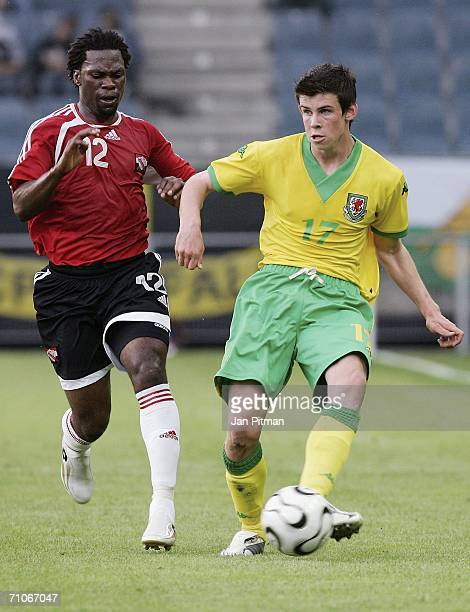 Gareth Bale of Wales and Collin Samuell of Trinidad and Tobago challenge during the friendly match between Wales and Trinidad and Tobago on May 27...