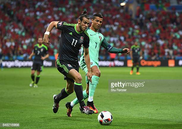 Gareth Bale of Wales and Cristiano Ronaldo of Portugal compete for the ball during the UEFA EURO 2016 semi final match between Portugal and Wales at...