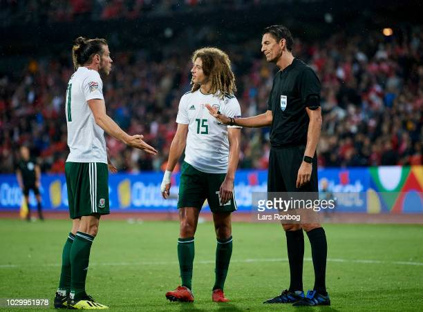 Gareth Bale of Wales and Ethan Ampadu of Wales showing frustration against Referee Deniz Aytekin of Germany during the UEFA Nations League match...