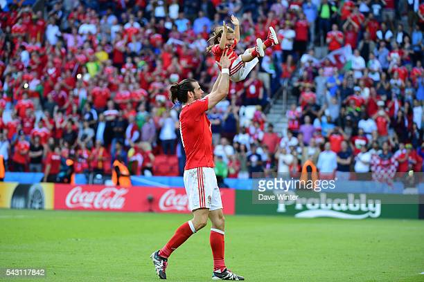 Gareth Bale of Wales and his daughter Alba Violet after the European Championship match Round of 16 between Wales and Northern Ireland at Parc des...