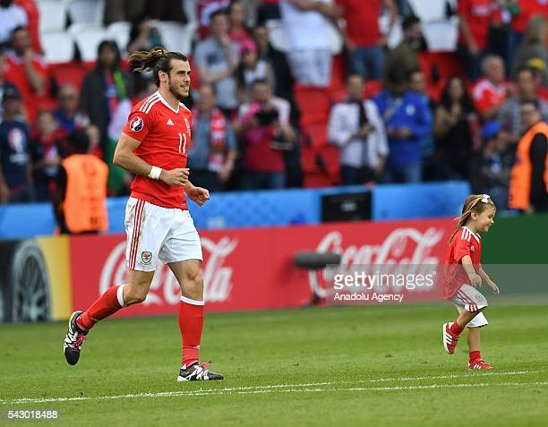 Gareth Bale of Wales and his daughter Alba Violet celebrate after the Euro 2016 round of 16 football match between Wales and North Ireland at Parc...