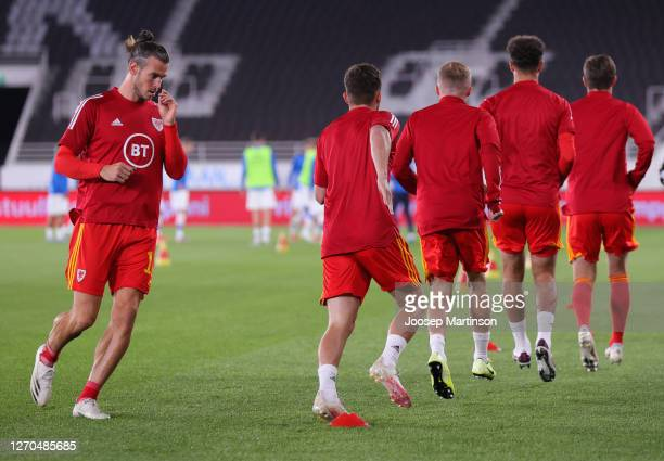 Gareth Bale of Wales and his teammates warm up prior to the UEFA Nations League group stage match between Finland and Wales at Helsingin...