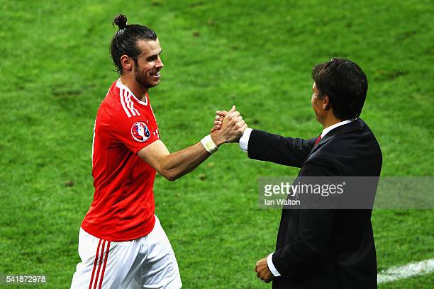 Gareth Bale of Wales and manager Chris Coleman shake hands after replaced during the UEFA EURO 2016 Group B match between Russia and Wales at Stadium...