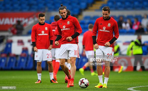 Gareth Bale of Wales and Paul Dummett of Wales in action during the warm up prior to the 2018 FIFA World Cup Qualifier Group D match between Wales...