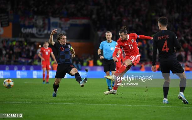 Gareth Bale of Wales attempts a shot on goal as Luka Modric of Croatia attempts to block during the UEFA Euro 2020 qualifier between Wales and...