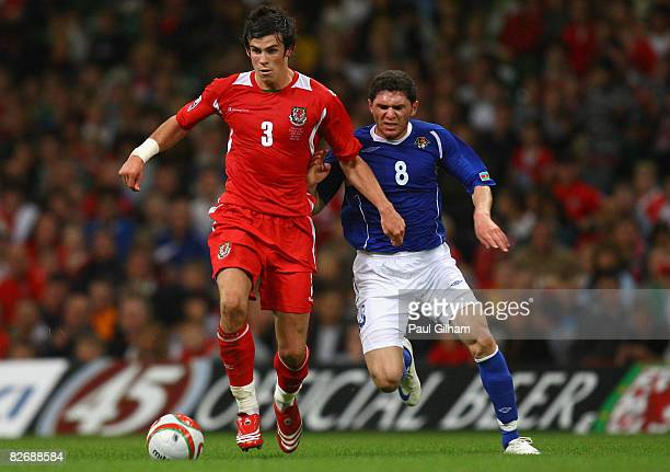 Gareth Bale of Wales battles for the ball with Djavid Huseinov of Azerbaijan during the FIFA 2010 World Cup Group Four Qualifying match between Wales...