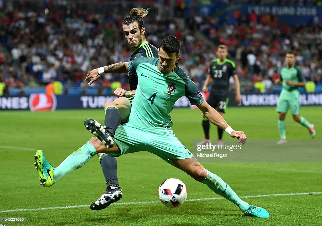 Gareth Bale of Wales battles for the ball with Jose Fonte of Portugal during the UEFA EURO 2016 semi final match between Portugal and Wales at Stade des Lumieres on July 6, 2016 in Lyon, France.