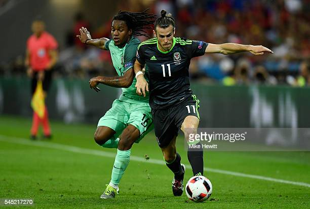 Gareth Bale of Wales battles for the ball with Renato Sanches of Portugal during the UEFA EURO 2016 semi final match between Portugal and Wales at...
