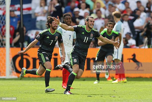 Gareth Bale of Wales celebrates after he scores during the UEFA EURO 2016 Group B match between England v Wales at Stade BollaertDelelis on June 16...
