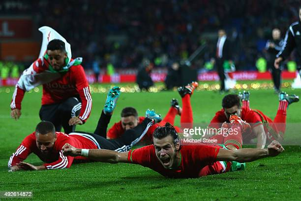 Gareth Bale of Wales celebrates after his sides 20 victory and qualification during the UEFA EURO 2016 Qualifier match at the Cardiff City Stadium on...