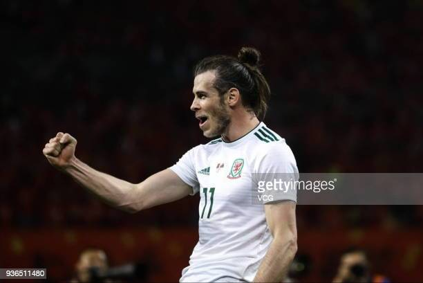 Gareth Bale of Wales celebrates after scoring his team's sixth goal during the 2018 China Cup International Football Championship match between China...