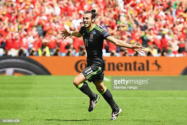 Gareth Bale of Wales celebrates after scoring the first goal during the UEFA EURO 2016 Group B match between England and Wales at Stade...