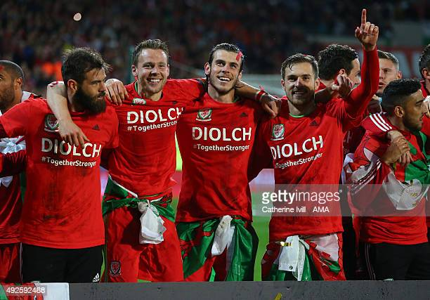Gareth Bale of Wales celebrates alongside team mates Joe Ledley Chris Gunter and Aaron Ramsey of Wales after the UEFA EURO 2016 Qualifier match...