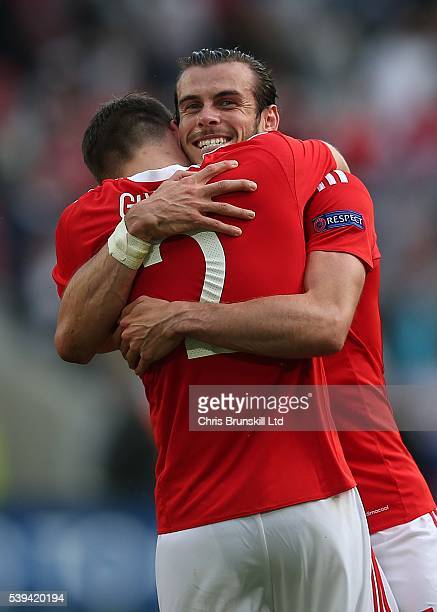 Gareth Bale of Wales celebrates at fulltime with teammate Chris Gunther following the UEFA Euro 2016 Group B match between Wales and Slovakia at...