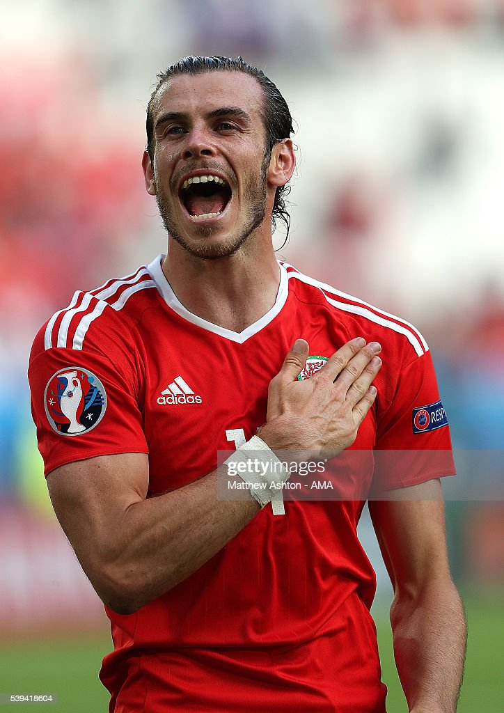 Gareth Bale of Wales celebrates at the end of the UEFA EURO 2016 Group B match between Wales and Slovakia at Stade Matmut Atlantique on June 11, 2016 in Bordeaux, France.