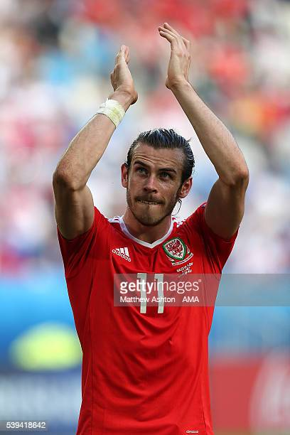 Gareth Bale of Wales celebrates at the end of the UEFA EURO 2016 Group B match between Wales and Slovakia at Stade Matmut Atlantique on June 11 2016...
