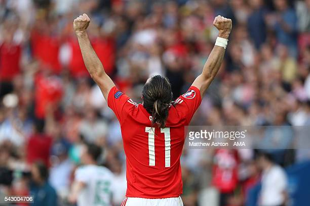 Gareth Bale of Wales celebrates at the end of the UEFA Euro 2016 Round of 16 match between Wales and Northern Ireland at Parc des Princes on June 25,...