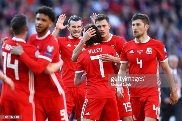 Gareth Bale of Wales celebrates at the full time whistle with his teammates during the 2020 UEFA European Championships group E qualifying match...