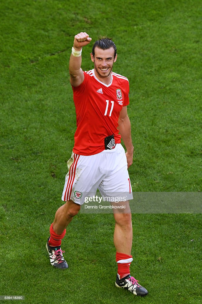 Gareth Bale of Wales celebrates his team's 2-1 win in the UEFA EURO 2016 Group B match between Wales and Slovakia at Stade Matmut Atlantique on June 11, 2016 in Bordeaux, France.