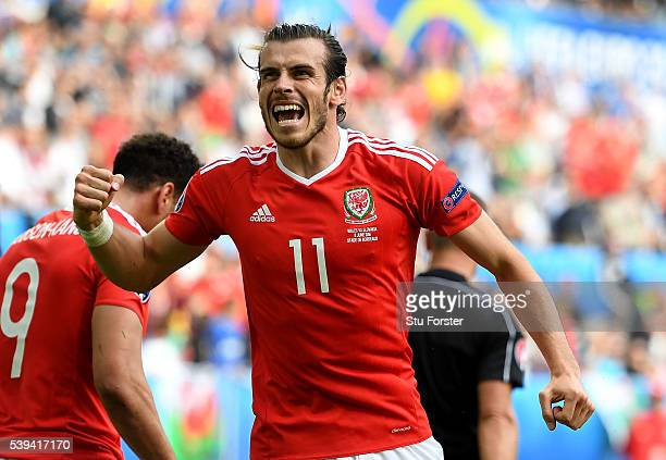 Gareth Bale of Wales celebrates his team's second goal during the UEFA EURO 2016 Group B match between Wales and Slovakia at Stade Matmut Atlantique...
