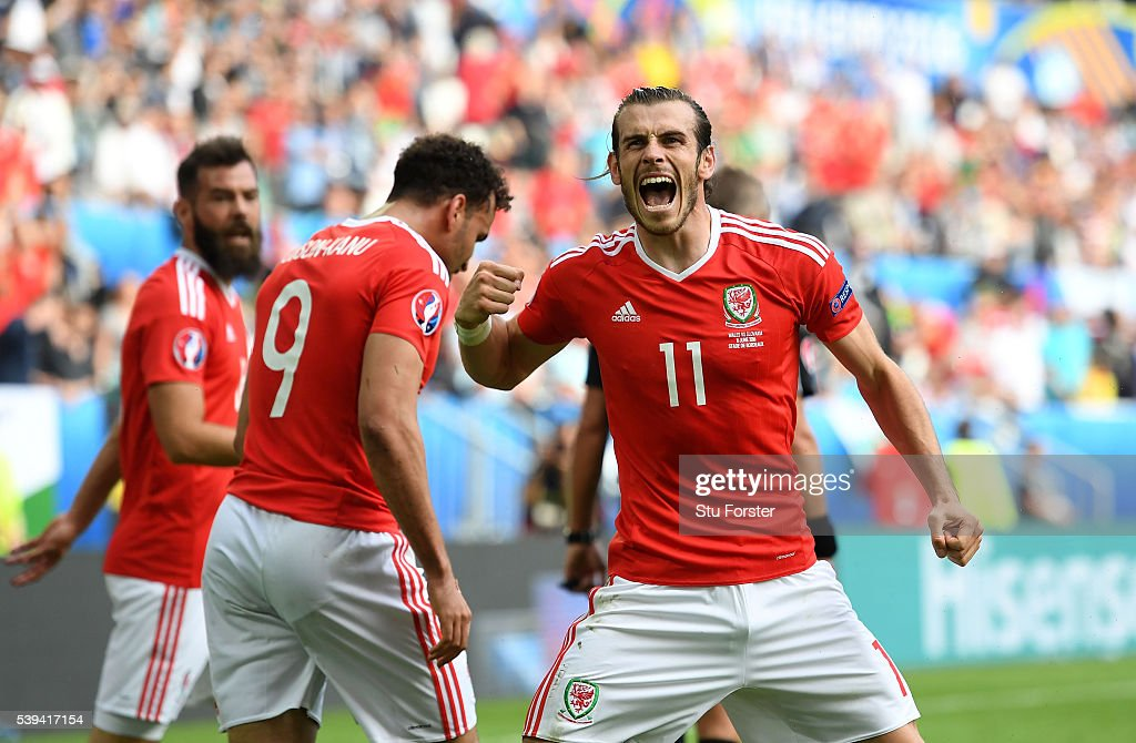 Gareth Bale (R) of Wales celebrates his team's second goal scored by Hal Robson-Kanu (C) during the UEFA EURO 2016 Group B match between Wales and Slovakia at Stade Matmut Atlantique on June 11, 2016 in Bordeaux, France.