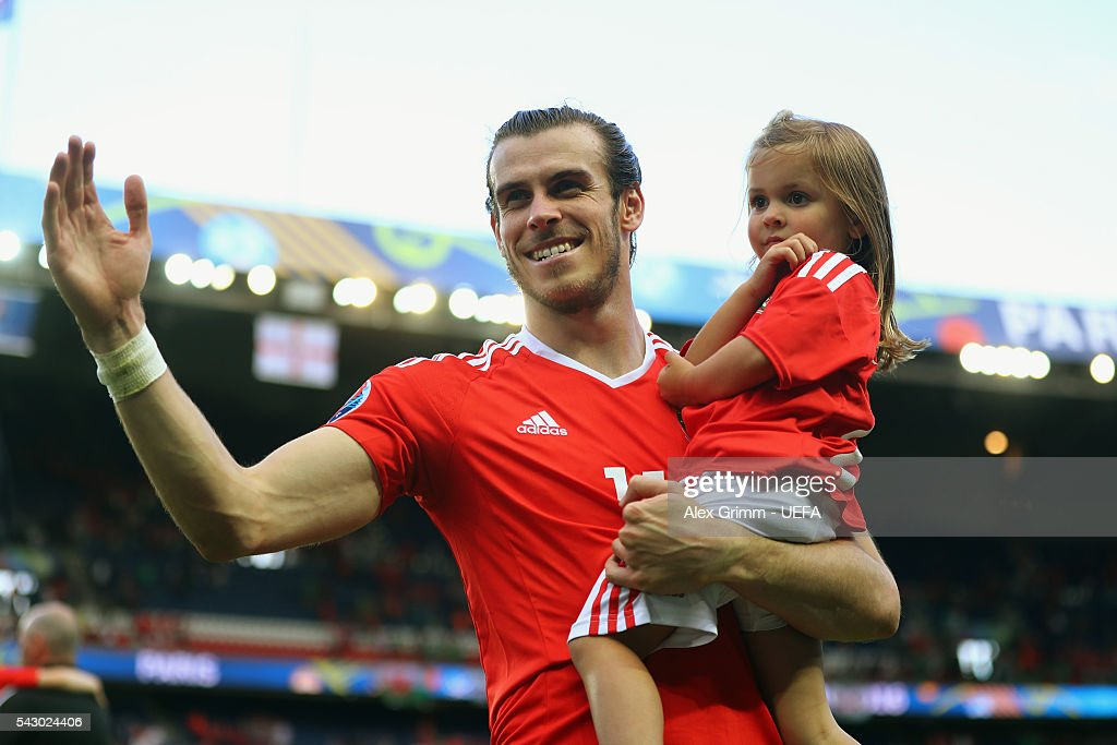 Gareth Bale of Wales celebrates his team's win with his daughter Alba Violet after the UEFA EURO 2016 round of 16 match between Wales and Northern Ireland at Parc des Princes on June 25, 2016 in Paris, France.