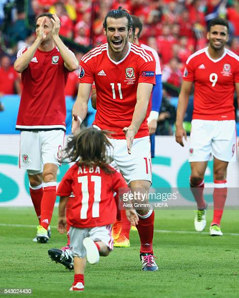 Gareth Bale of Wales celebrates his team's win with his daughter Alba Violet after the UEFA EURO 2016 round of 16 match between Wales and Northern...